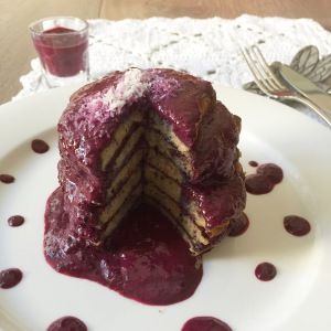 Maca and cinnamon pancake stack with blueberry and macadamia sauce