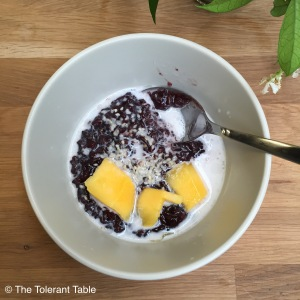 Black rice with coconut and almond milk and fresh mango